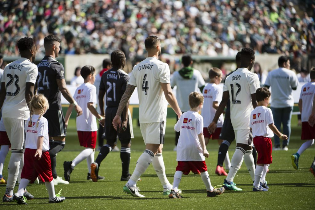 Apr 22, 2018; Portland, OR, USA; New York City walks out with escorts before a game against the Portland Timbers at Providence Park. The Timbers won 3-0. Mandatory Credit: Troy Wayrynen-USA TODAY Sports
