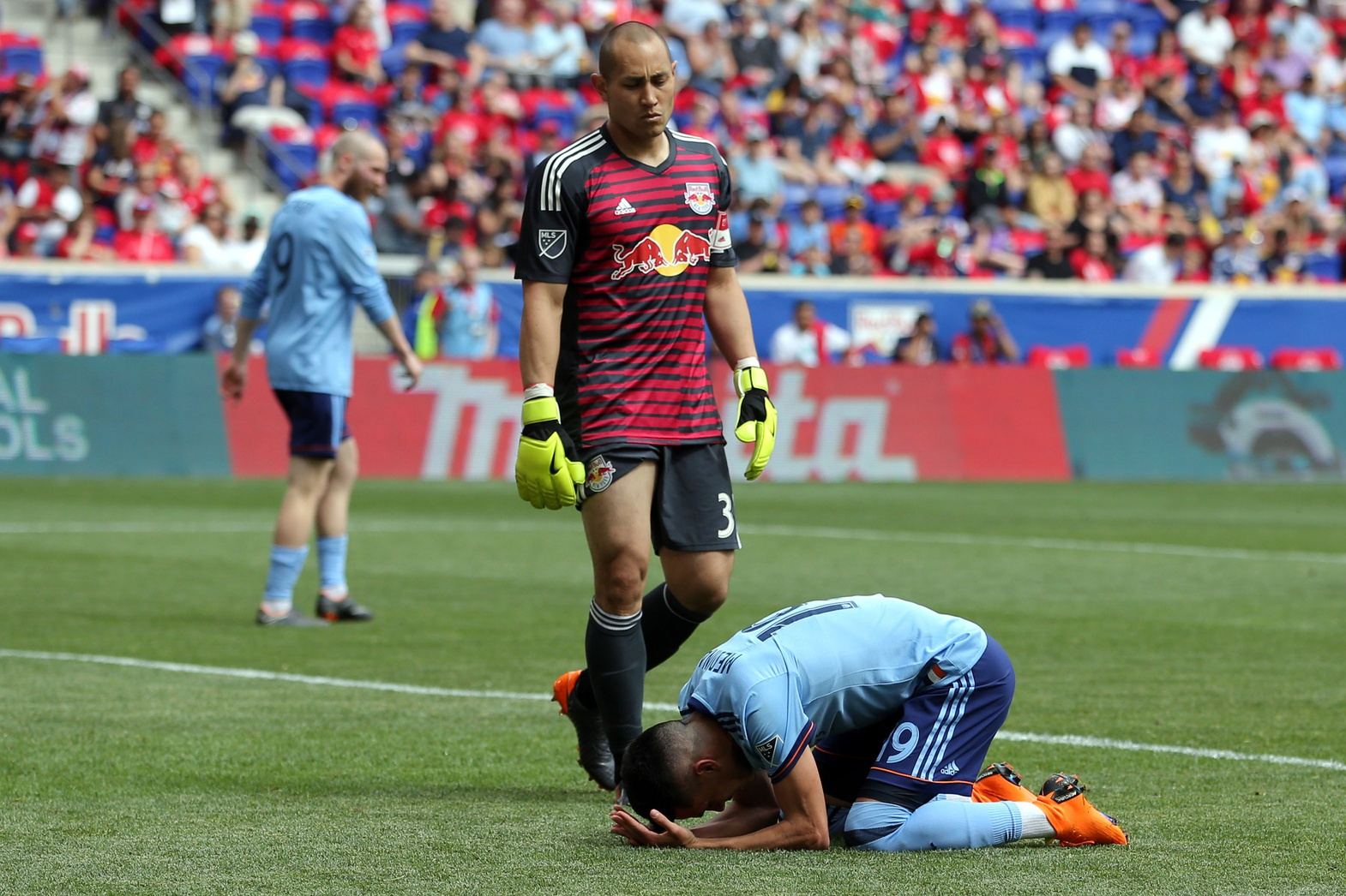 May 5, 2018; Harrison, NJ, USA; New York City FC midfielder Jesus Medina (19) reacts after missing an open header in front of New York Red Bulls goalkeeper Luis Robles (31) during the second half at Red Bull Arena. Mandatory Credit: Brad Penner-USA TODAY Sports