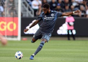 May 13, 2018; Los Angeles, CA, Los Angeles, CA, USA; New York City FC defender Sebastien Ibeagha (33) clears the ball against Los Angeles FC during the first half at Banc of California Stadium. Mandatory Credit: Gary A. Vasquez-USA TODAY Sports