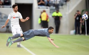 May 13, 2018; Los Angeles, CA, Los Angeles, CA, USA; New York City FC forward David Villa (7) scores a goal ahead of Los Angeles FC midfielder Benny Feilhaber (33) during the first half at Banc of California Stadium. Mandatory Credit: Gary A. Vasquez-USA TODAY Sports