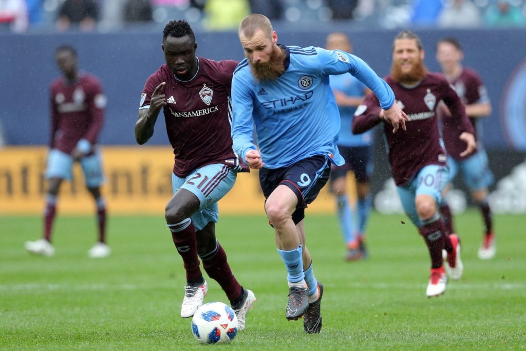 May 19, 2018; New York, NY, USA; New York City FC forward Jo Inge Berget (9) plays the ball against Colorado Rapids midfielder Bismark Adjei-Boateng (21) during the first half at Yankee Stadium. Mandatory Credit: Brad Penner-USA TODAY Sports