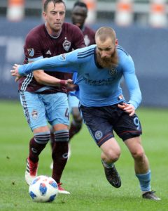 May 19, 2018; New York, NY, USA; New York City FC forward Jo Inge Berget (9) and Colorado Rapids defender Danny Wilson (4) fight for the ball during the first half at Yankee Stadium. Mandatory Credit: Brad Penner-USA TODAY Sports