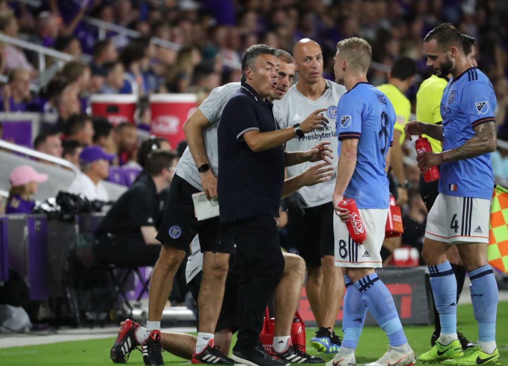 Jul 26, 2018; Orlando, FL, USA;New York City FC head coach Domenec Torrent talks with midfielder Alexander Ring (8) against the Orlando City SC during the first half at Orlando City Stadium. Mandatory Credit: Kim Klement-USA TODAY Sports
