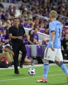 Jul 26, 2018; Orlando, FL, USA; New York City FC head coach Domenec Torrent talks with defender Anton Tinnerholm (3) during the second half against the Orlando City SC during the second half at Orlando City Stadium. Mandatory Credit: Kim Klement-USA TODAY Sports