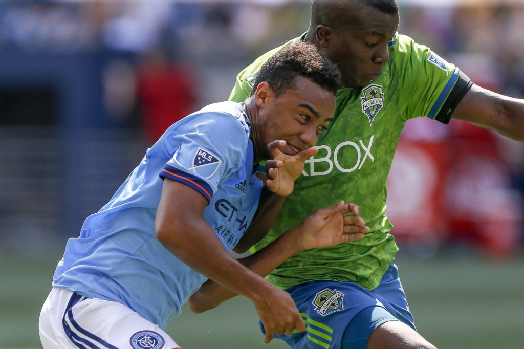 Jul 29, 2018; Seattle, WA, USA; Seattle Sounders FC defender Nouhou (5) blocks out New York City FC forward Jonathan Lewis (17) during the second half at CenturyLink Field. Mandatory Credit: Jennifer Buchanan-USA TODAY Sports