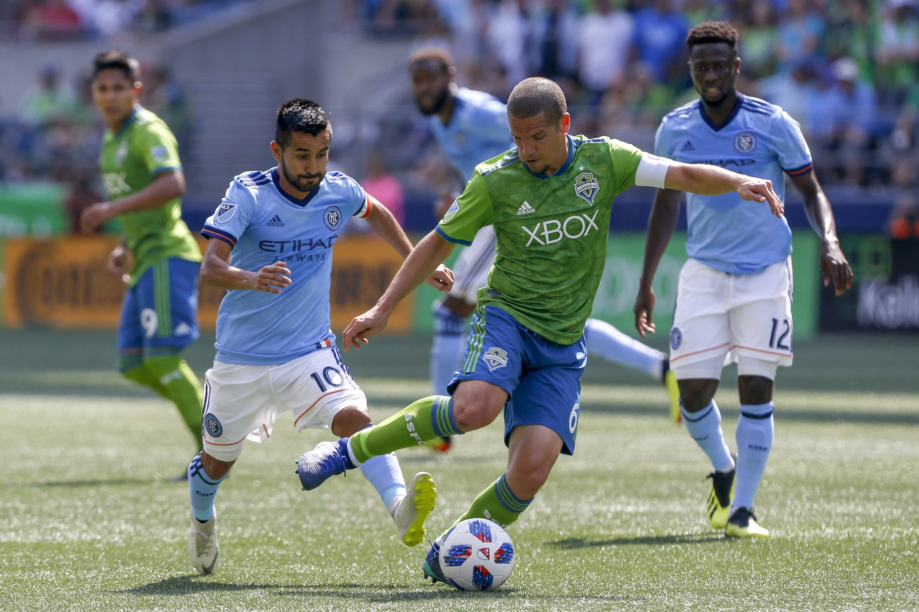 Jul 29, 2018; Seattle, WA, USA; Seattle Sounders FC midfielder Osvaldo Alonso (6) dribbles the ball against New York City FC midfielder Maximiliano Moralez (10) during the second half at CenturyLink Field. Mandatory Credit: Jennifer Buchanan-USA TODAY Sports