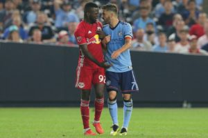 Aug 22, 2018; New York, NY, USA; New York Red Bulls defender Kemar Lawrence (92) and New York City FC forward David Villa (7) exchange words during the second half at Yankee Stadium. Mandatory Credit: Brad Penner-USA TODAY Sports
