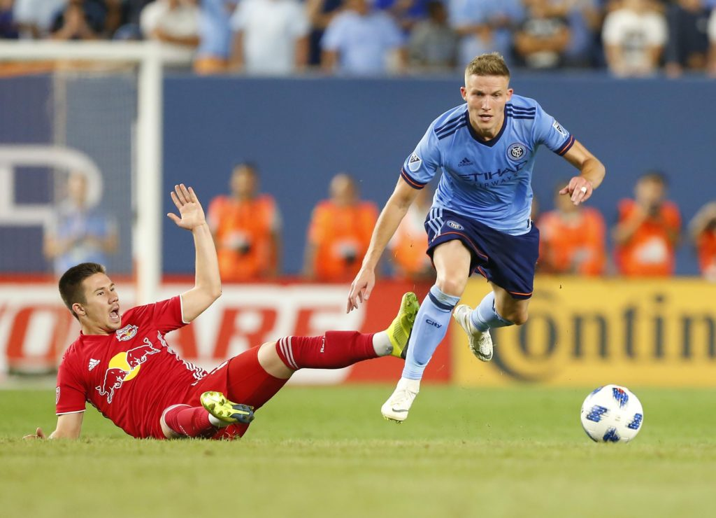 Aug 22, 2018; New York, NY, USA; New York City midfielder Alexander Ring (8) plays the ball against New York Red Bulls midfielder Alex Muyl (19) during second half at Yankee Stadium. Mandatory Credit: Noah K. Murray-USA TODAY Sports