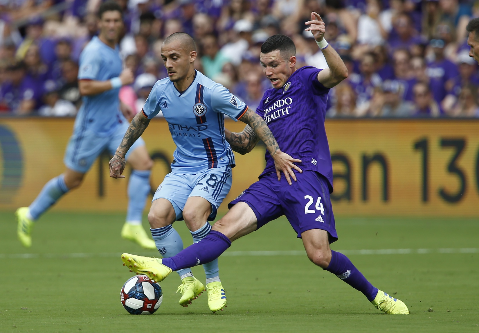 Mar 2, 2019; Orlando, FL, USA; Orlando City FC defender Kyle Smith (24) and New York City FC midfielder Alexandru Mitrita (28) battle for possession during the first half of a soccer match at Orlando City Stadium. Mandatory Credit: Reinhold Matay-USA TODAY Sports