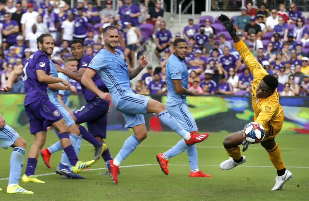 Mar 2, 2019; Orlando, FL, USA; New York City FC goalkeeper Sean Johnson (right) allows a goal from Orlando City FC forward Chris Mueller (not pictured) during the second half of a soccer match at Orlando City Stadium. Mandatory Credit: Reinhold Matay-USA TODAY Sports
