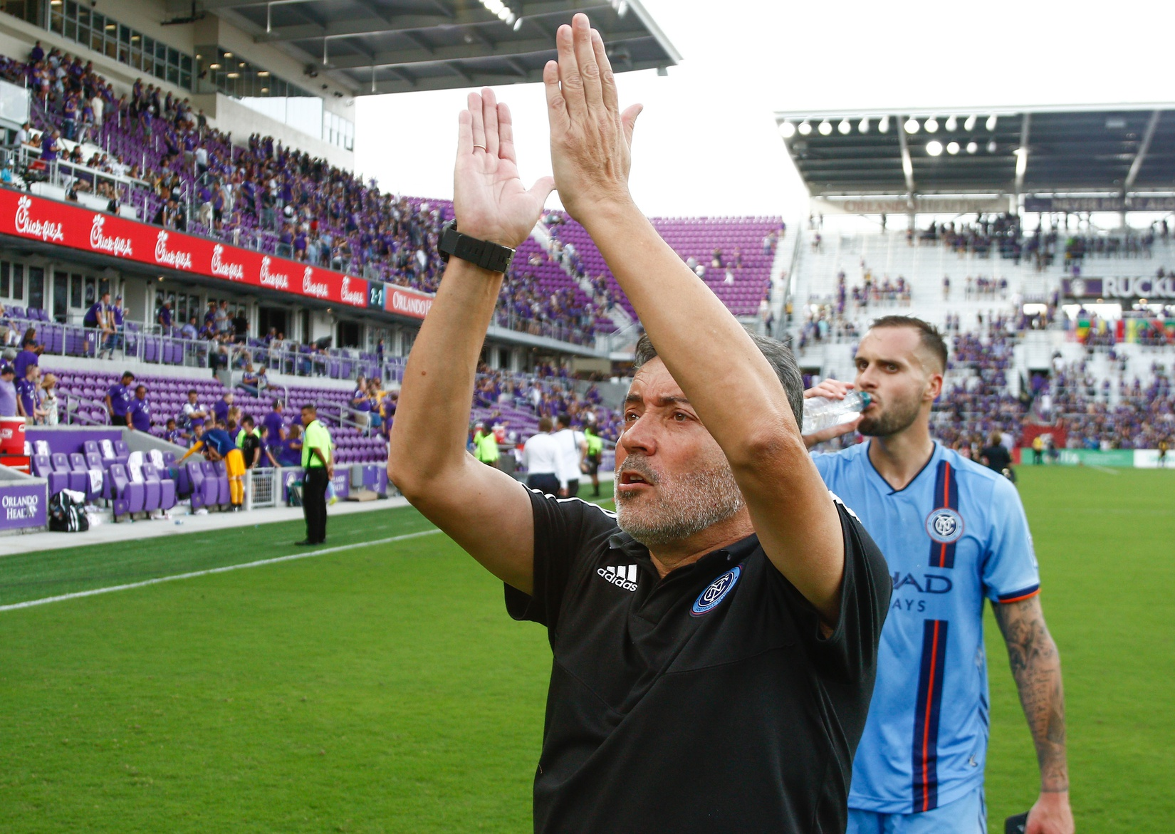 Mar 2, 2019; Orlando, FL, USA; New York City FC coach Domenec Torrent applauds his fans as he leaves the field following a soccer match against the Orlando City FC at Orlando City Stadium. Mandatory Credit: Reinhold Matay-USA TODAY Sports