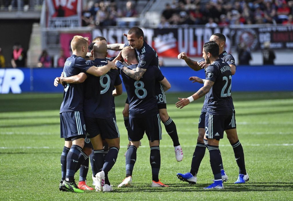 Apr 21, 2019; Washington, D.C., USA; New York City midfielder Alexandru Mitrita (28) celebrates with teammates after scoring a goal against the D.C. United during the first half at Audi Field. Mandatory Credit: Brad Mills-USA TODAY Sports