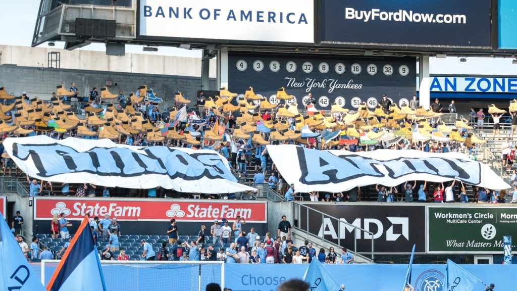 Jul 7, 2019; New York, NY, USA; New York City FC fans hold banners before the game between New York City FC and the Portland Timbers at Yankee Stadium. Mandatory Credit: Vincent Carchietta-USA TODAY Sports