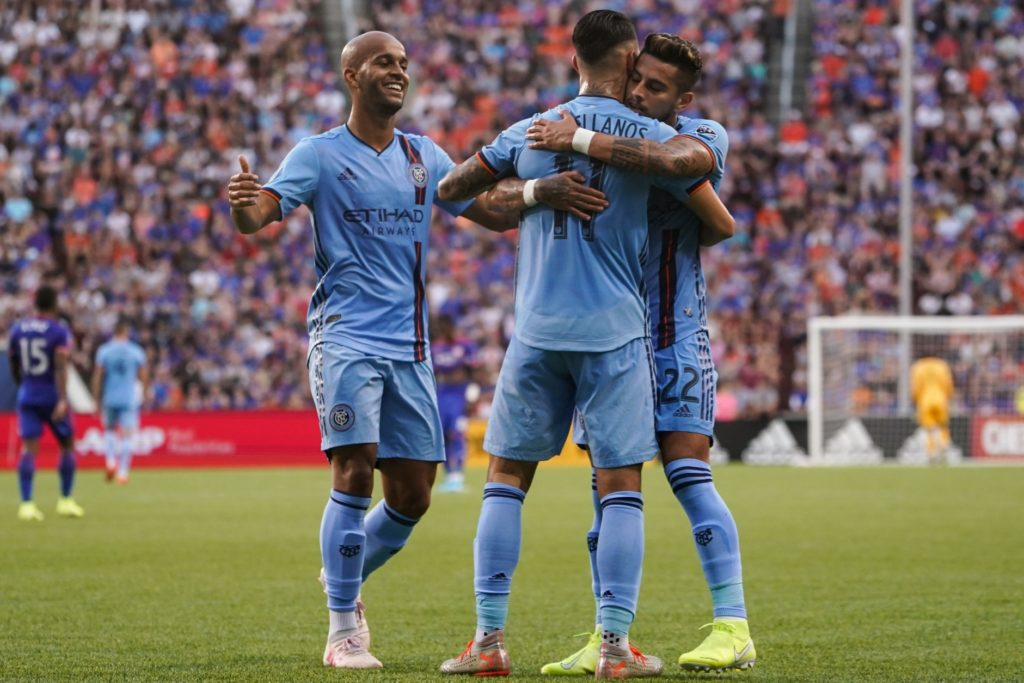 Aug 17, 2019; Cincinnati, OH, USA; New York City FC midfielder Valentin Castellanos (11) celebrates with teammates defender Ronald Matarrita (right) and forward Heber (left) after scoring a goal against FC Cincinnati in the first half at Nippert Stadium. Mandatory Credit: Aaron Doster-USA TODAY Sports