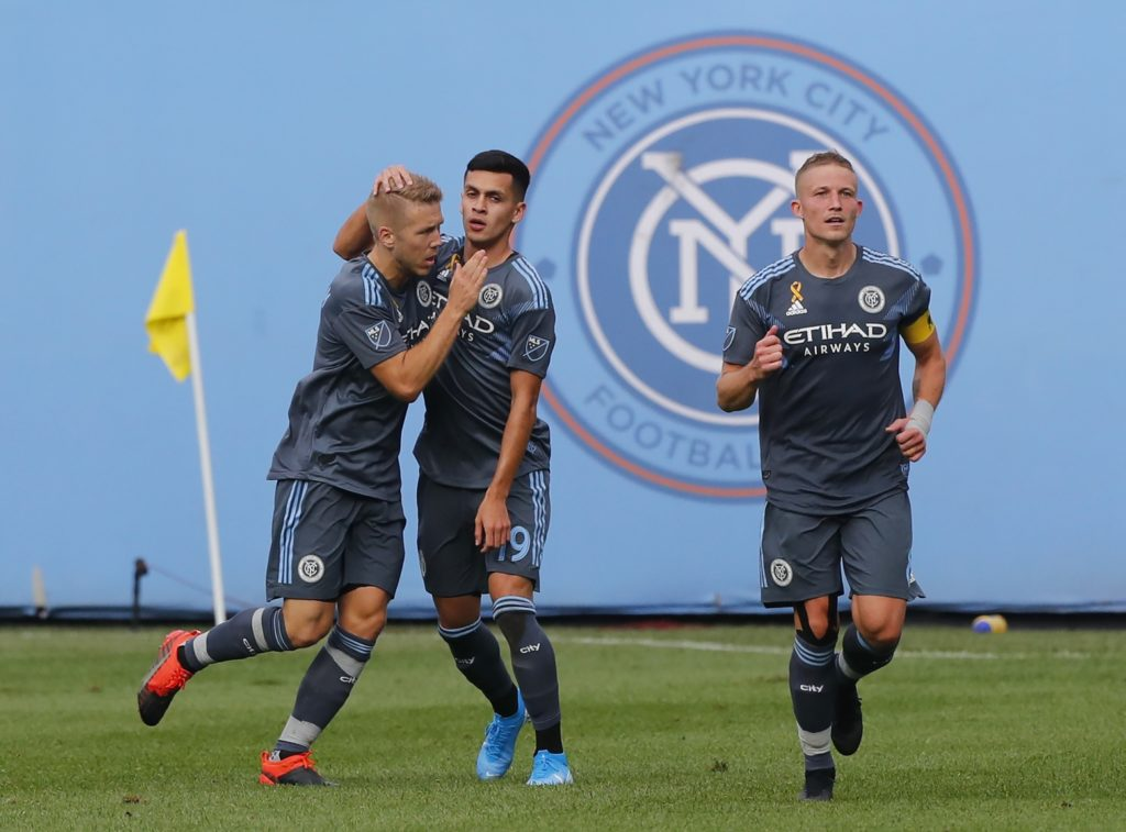 Sep 7, 2019; New York, NY, USA; New York City FC defender Anton Tinnerholm (3) and New York City FC forward Jesus Medina (19) celebrate after a goal against the New England Revolution during the second half at Yankee Stadium. Mandatory Credit: Noah K. Murray-USA TODAY Sports